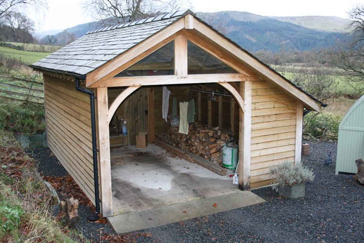 Car garage with log store