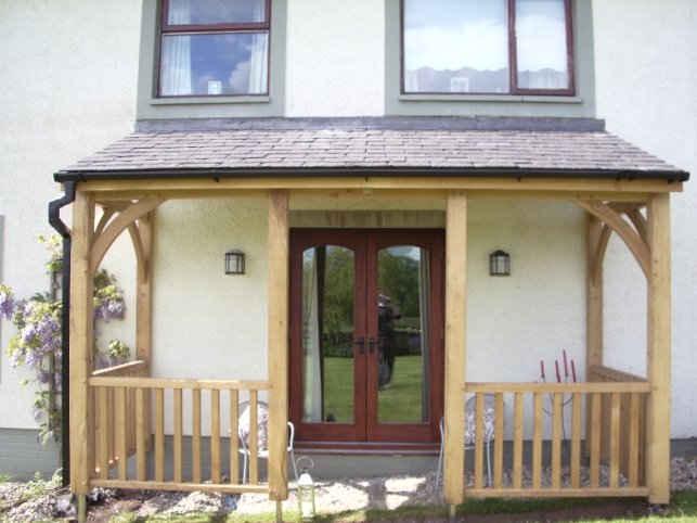 Wooden veranda with side rails